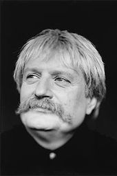 Karl Jenkins. Be sure to search on his image on the web. This is a very conservative portrait of a very colorful guy.