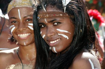 Dressed in Taino garb and makeup, two contemporary Dominican girls demonstrate that these were real people with families and traditions. Each year, we celebrate an American hero who killed most of the Taino people.
