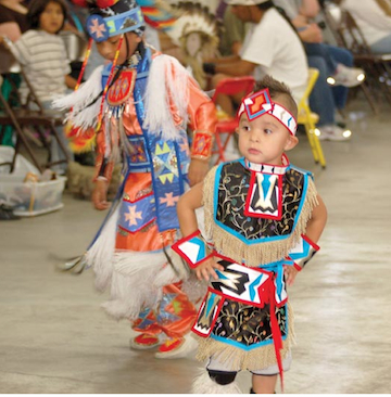 One of the ten cutest kids in a May, 2014 story about Indian pow-wows. For more up-to-date news about native Americans, click on the image.