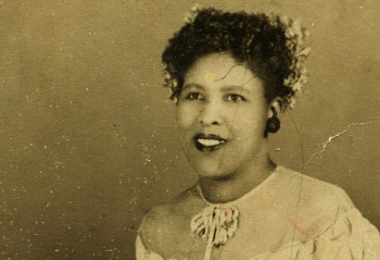 Ida Mae, with flowers in her hair, sharecroppers' daughter, living in Chicago in the 1930s