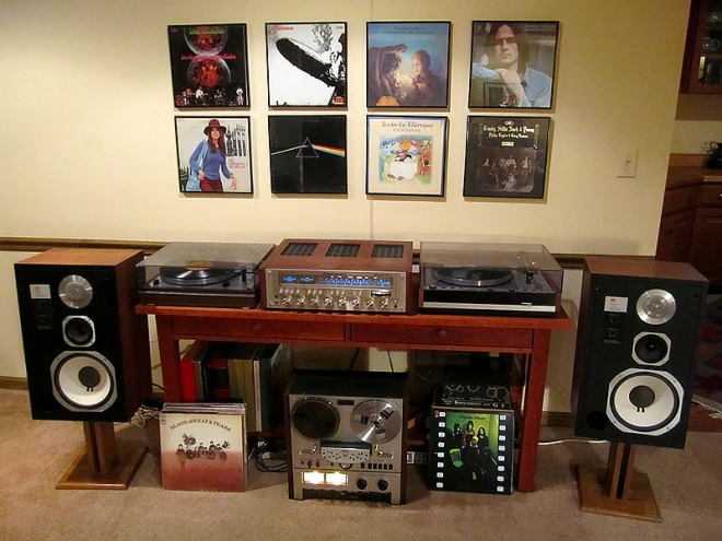 Here's a wonderful example of a 1970s stereo system (but few people owned two turntables). This image comes from a collector of 1970s stereo equipment (click on the link for more pictures and some stories). You are looking at: a Marantz 2330b receiver, a Thorens TD-165 turntable, a Thorens TD-126 turntable, JBL L96 speakers, and an Akai GX-266D reel to reel tape deck.
